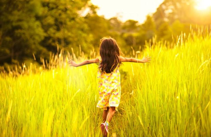 little-girl-running-through-weeds